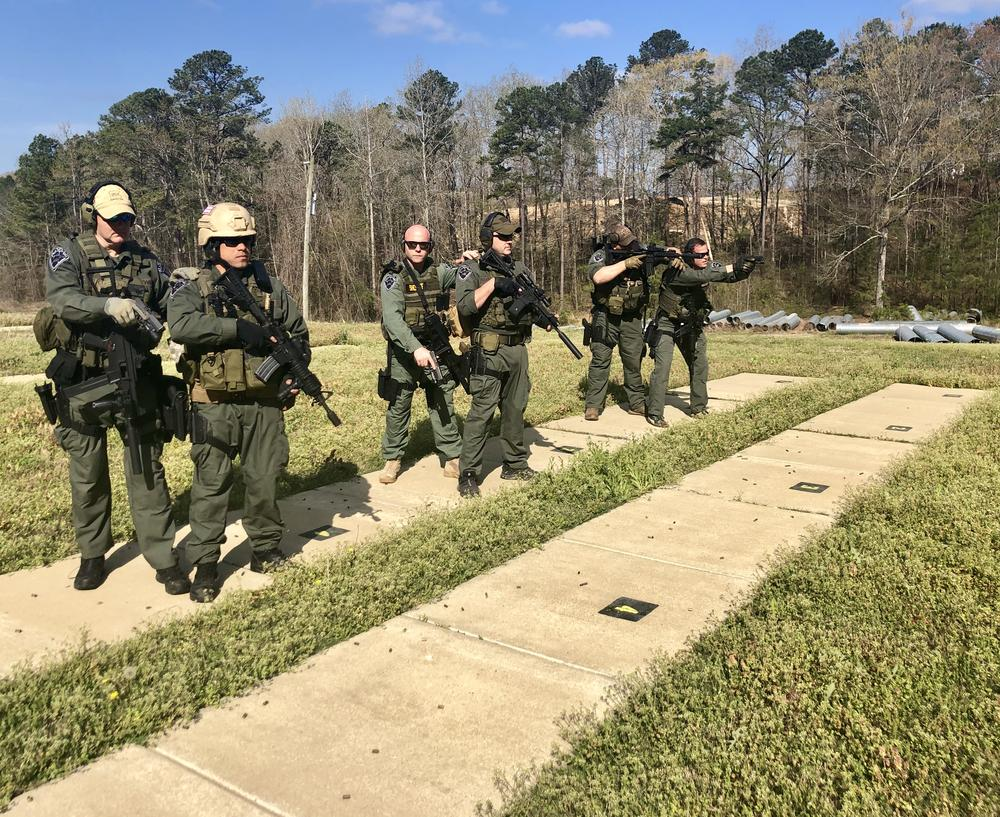 Swat men practicing with weapons