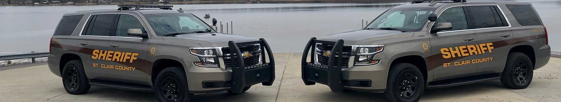 St. Clair County Sheriff's Office patrol vehicles parked in front of lake